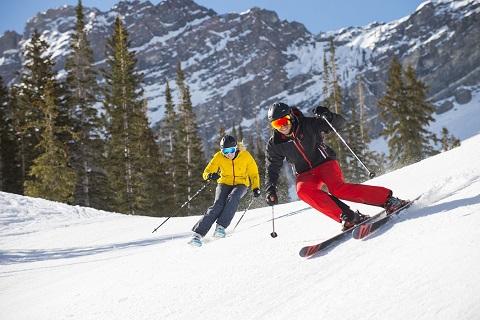Man and Woman skiing Alta