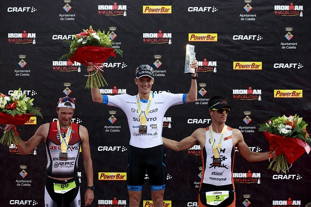 BARCELONA, SPAIN - OCTOBER 02: First place winner Patrick Nilsson (2ndL) from Sweden pose for a picture with second place winner Ivan Tutukin (L) from Russia and third place winner Mikel Blanchart (R) from Spain on the top three podium during the award ceremony of the Ironman Barcelona ceremony award on October 2, 2016 in Calella, Spain. (Photo by Gonzalo Arroyo Moreno/Getty Images)